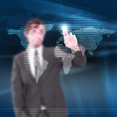 Young man touches a virtual surface. — Stock Photo