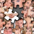 Puzzle from different human faces — Stockfoto