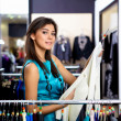 Young womin shop buying clothes — Stock Photo #5243539