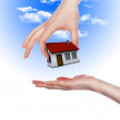 House in the hands against the blue sky — Stock Photo #5301152