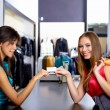 Young womin shop buying clothes — Stock Photo #5301262