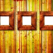 Three wooden frame on old wall — Stock Photo