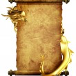 Dragon and scroll of old parchment — Stock Photo