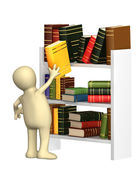 Puppet getting from a shelf the book — Stock Photo