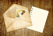 Old envelope with photos — Stock Photo