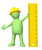 Puppet with ruler — Stock Photo