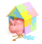 Piggy bank, house and key — Stock Photo