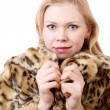 Beautiful young woman in a fur coat - Stock Photo
