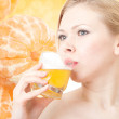 Beautiful women drinks juice — Stock Photo