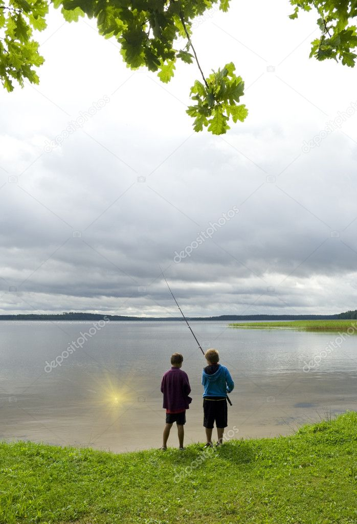 Two boys fishing sun from the water. — Stock Photo #4627741
