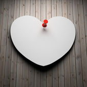 Blank paper heart on wood — Stock fotografie