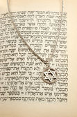 The Torah and silver chain with magen david — Stock Photo