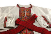 Traditional ukrainian male clothes - embroidered shirt and red — Stock Photo