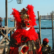 Stock Photo: Red mask at St. Mark's Square during Carni