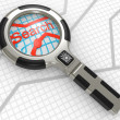 Magnifier on a map - Stock Photo