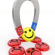 Smiling faces near to a magnet - Stock Photo