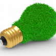 Green energy. Green grass on lightbulb surface — Stock Photo