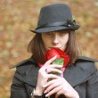 Stock Photo: Girl in hat with red rose