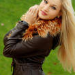 图库照片: Portrait blonde in brown leather jacket