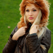 图库照片: Blonde in brown leather jacket