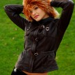 Foto Stock: Girl in brown leather jacket
