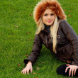 Foto Stock: Blonde in brown jacket