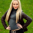 Stockfoto: Blonde in brown jacket