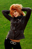 Girl in brown leather jacket — Stockfoto