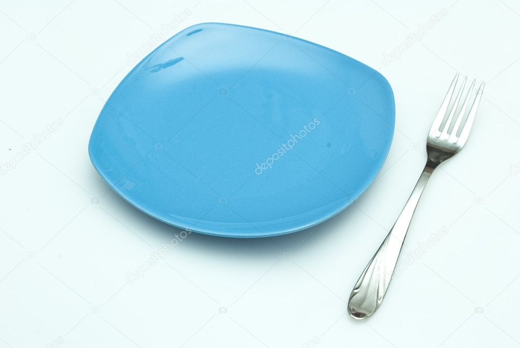 Plate and fork — Stock Photo #4151477