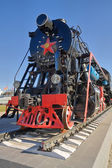Ancient steam locomotive with red star — Stock Photo