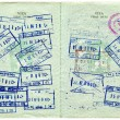 Visentry and exit stamps in passport — Stock Photo #4399799