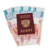 Russian passport on the batch of bills — Stock Photo