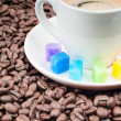 Stock Photo: Multicolored slabs of shugar and cup of coffee