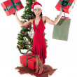 Happy woman with Christmas presents — Stock Photo