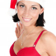 Portrait of beautiful woman in red santa hat — Stock Photo #4042272