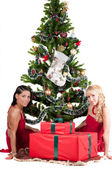 Happy women with Christmas presents — Stock Photo