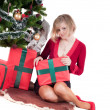 Happy woman with Christmas presents — Stock fotografie