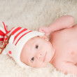 Newborn baby in chritstmas hat — Stock Photo