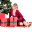 Happy woman with Christmas presents — Stok fotoğraf