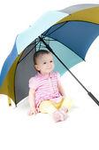 Cute baby girl under umbrella — Stock Photo