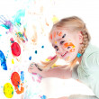 Little girl playing with colors — Stock Photo