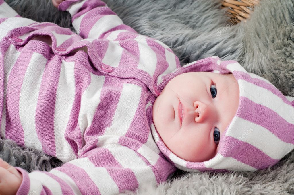 Shot of little cute baby in stripped clothes — Stock Photo #5363237