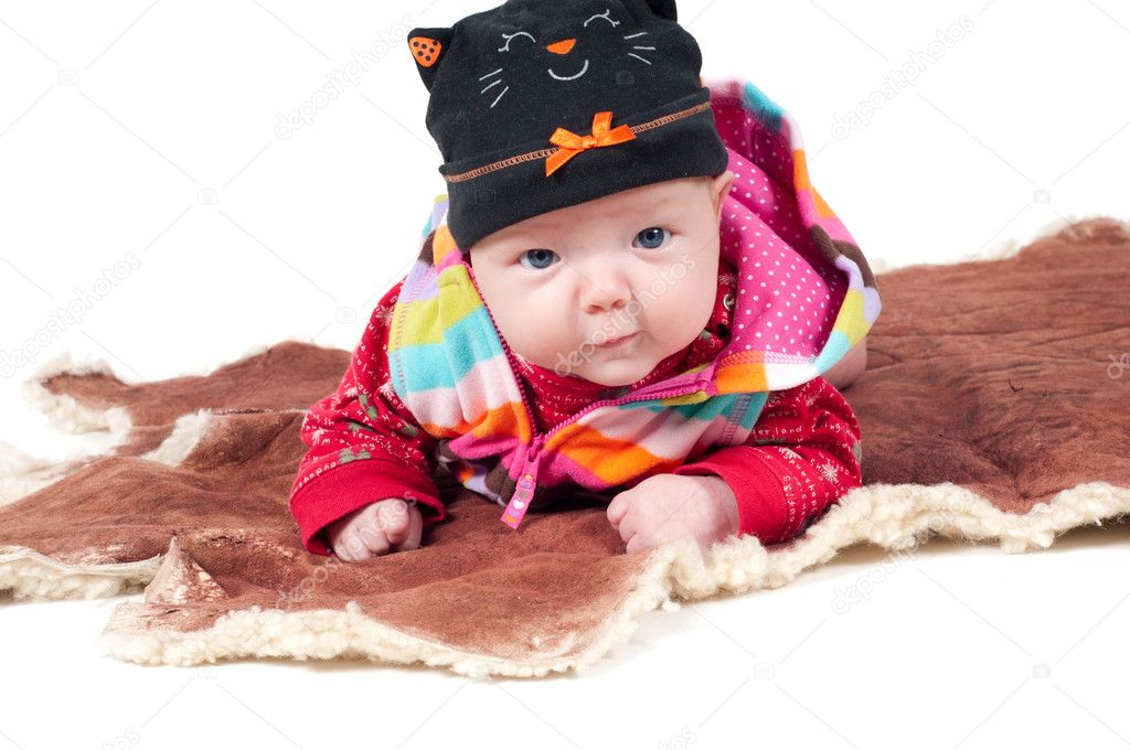 Shot of little cute baby in lying on fur — Stock Photo #5363245