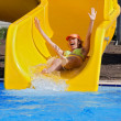 Girl on a waterslide — Stock Photo