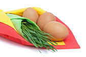 Three eggs with green grass — Stock Photo
