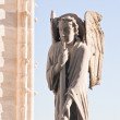 Sculpture of an angel on the roof of the Cathedral of Notre Dame — Stock Photo