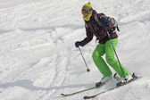 The woman is skiing at a ski resort — Stock Photo