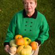 Senior woman with pumpkins — Stock Photo