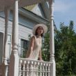 The girl on the porch of the old manor — Stock Photo #5125467
