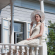 The girl on the porch of the old manor — Stock Photo